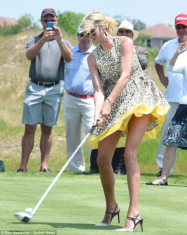 29187D1F00000578-3098533-Ivanka_showed_off_her_trim_legs_in_the_yellow_frock_which_featur-m-64_1432692664684